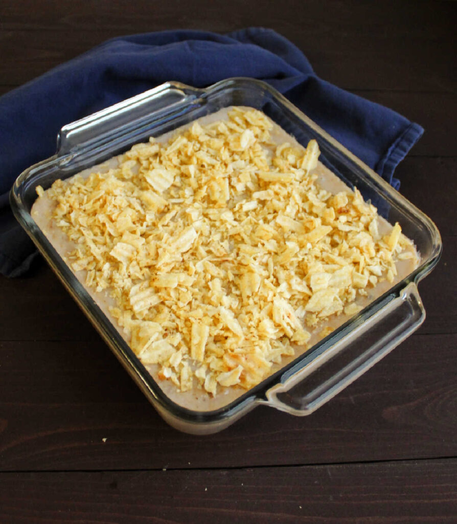 potato chip topped creamy tuna casserole fresh from the oven, ready to be served over rice.