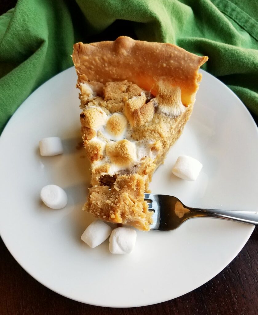 slice of peanut butter cookie pie with mini marshmallows baked in.