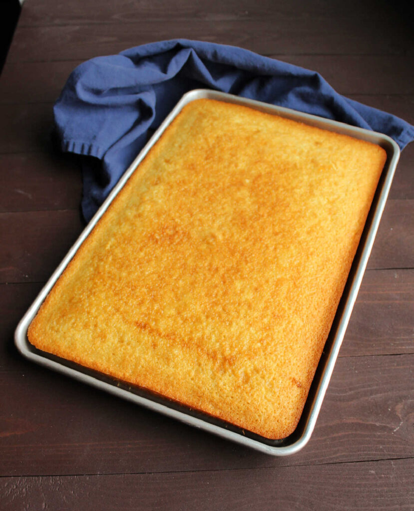 sheet pan filled with golden vanilla cake ready to be frosted.
