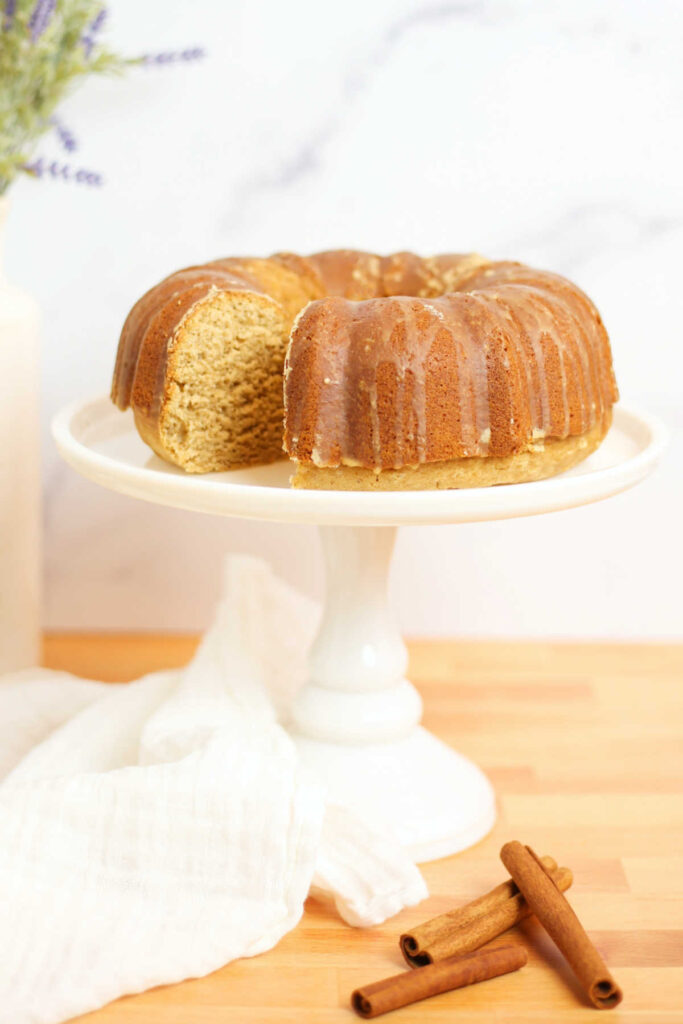 Chai bundt cake with espresso glaze on white cake stand.