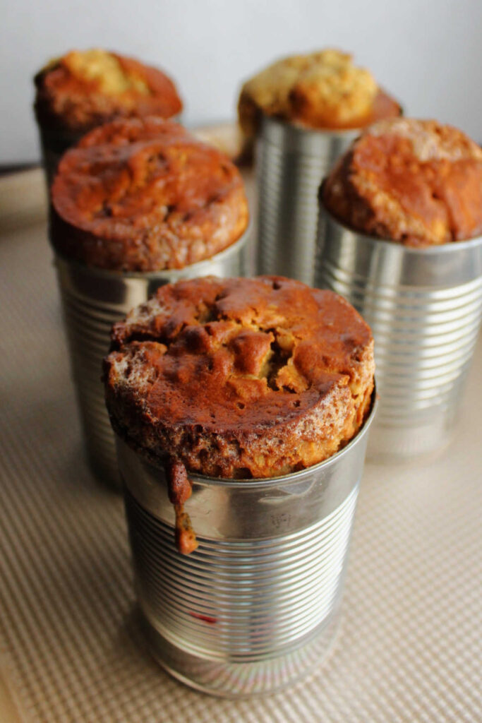 Date nut bread in cans fresh out of the oven.