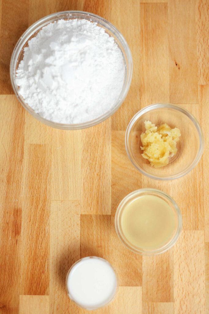 Ingredients for lemon ginger powdered sugar glaze.
