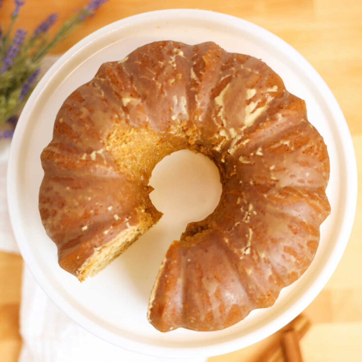 looking down on chai spiced bundt cake with espresso glaze on serving platter, ready to serve.