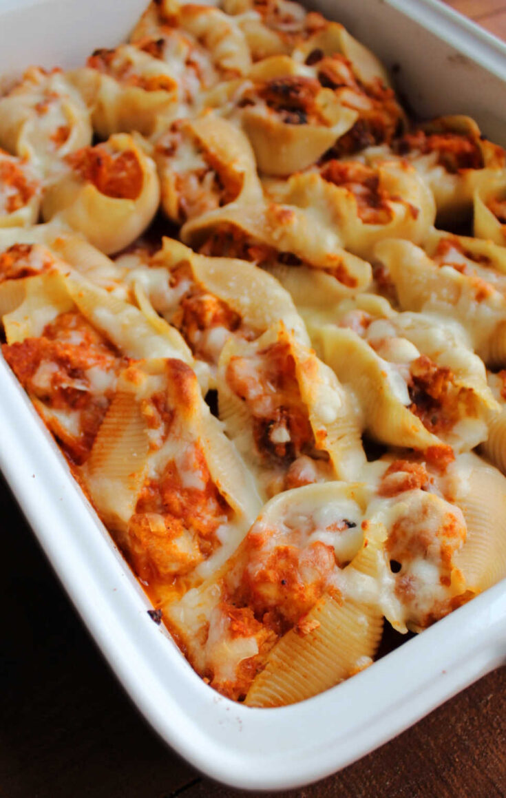 Pan of freshly baked chicken Parmesan baked shells.