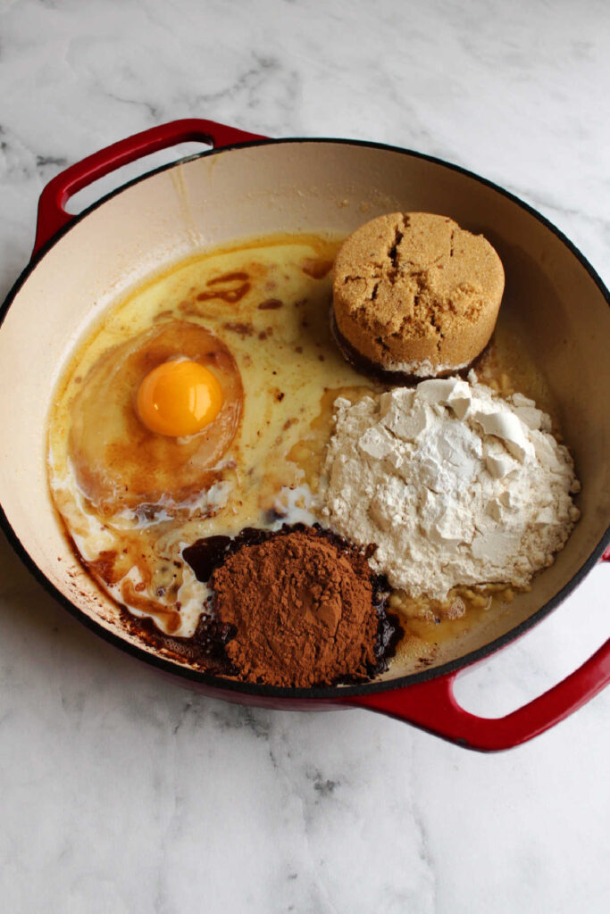 browned butter brownie ingredients in cast iron pan.