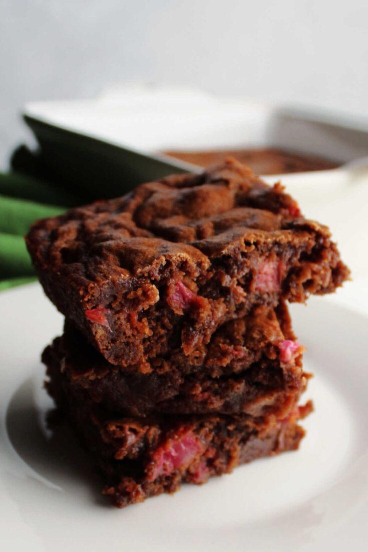 Stack of fudgy rhubarb brownies.