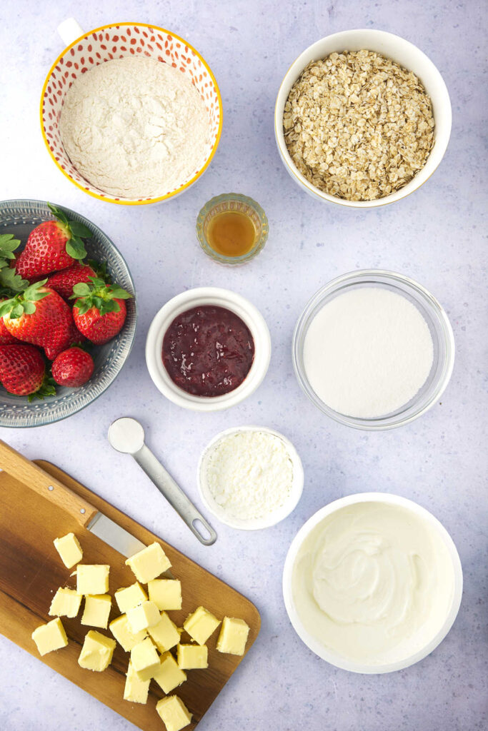 Ingredients for strawberry yogurt bars with oatmeal crumbs.