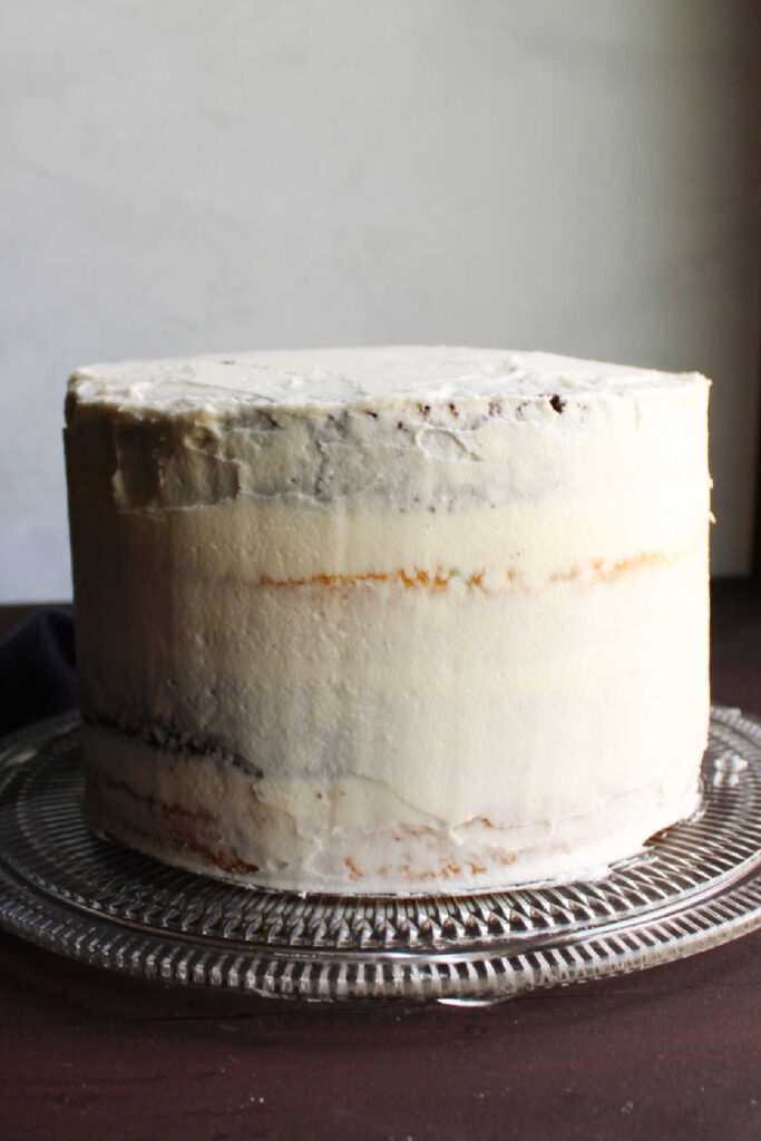 Layer cake with crumb coat of marshmallow buttercream.