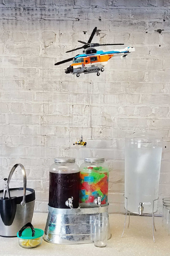 Beverage area with Lego helicopter floating over it.