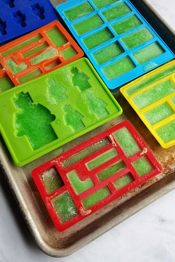 Silicone molds in lego shapes with jello inside.