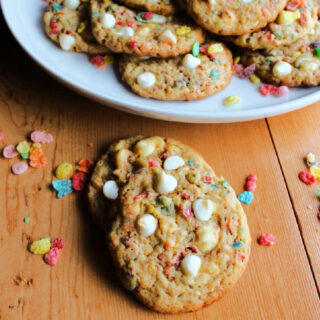 Colorful fruity pebble cookies with white chips.