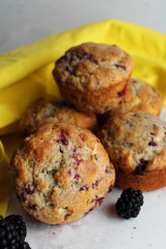 Pile of blackberry sour cream muffins.