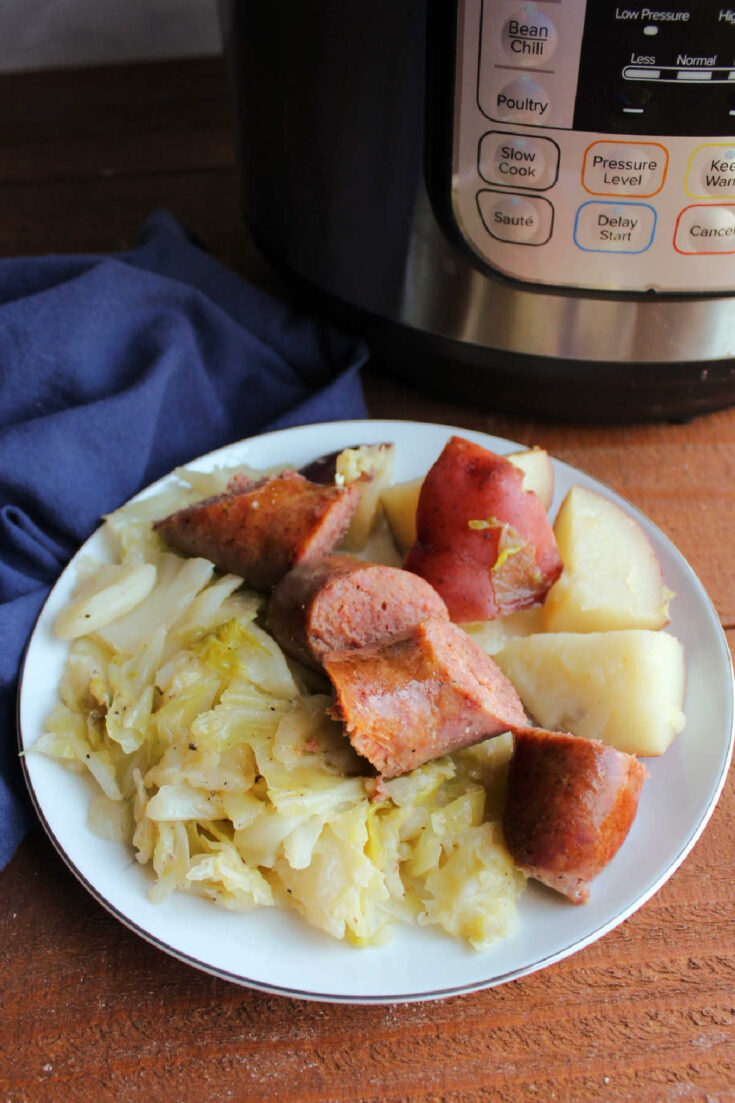 plate of keilbasa with potatoes and cabbage by instant pot.