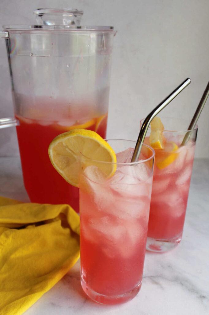 Glasses of freshly made pink lemonade.