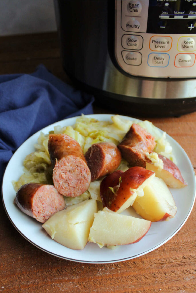 Dinner plate with cabbage, potatoes and keilbasa.