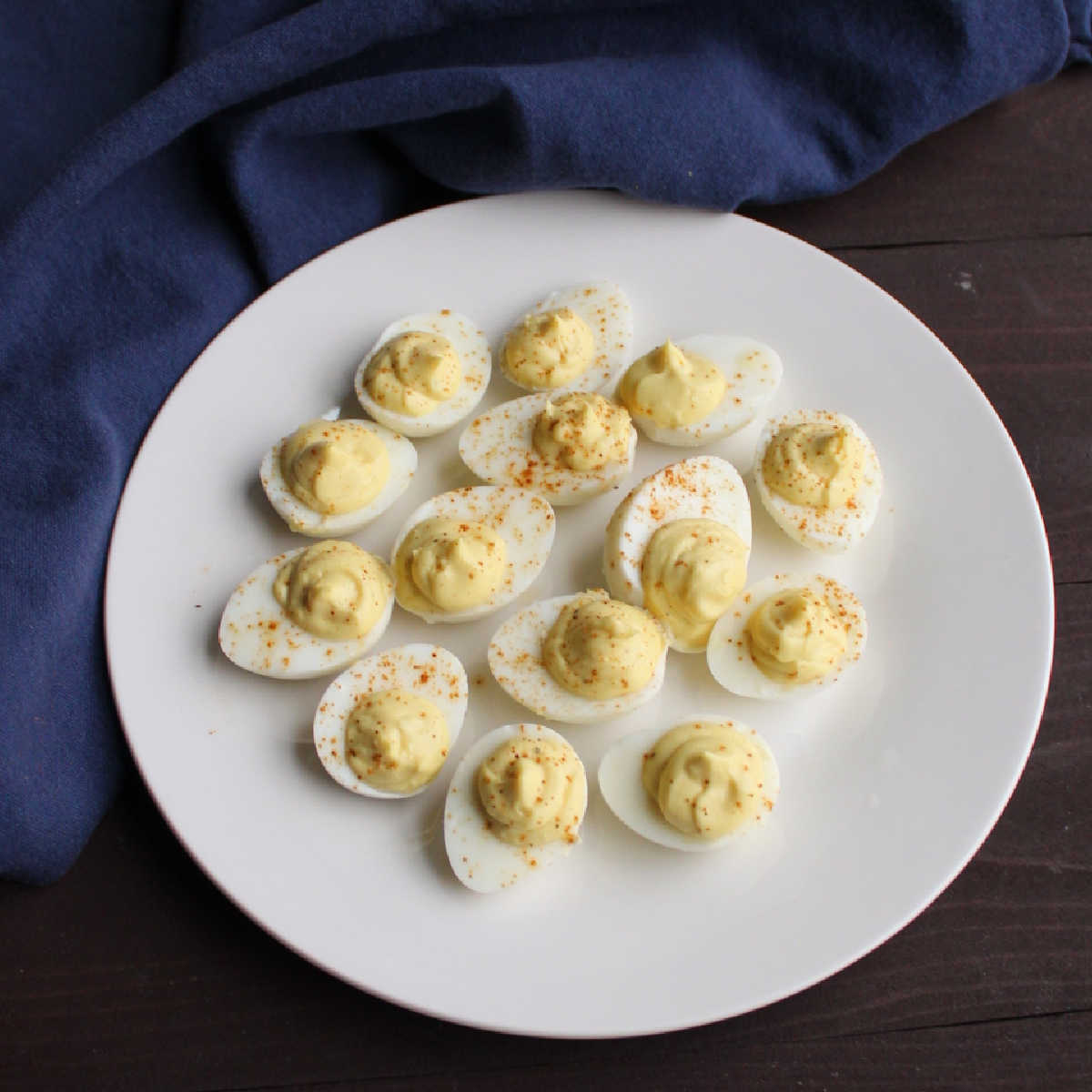 Plate filled with mini quail deviled eggs.