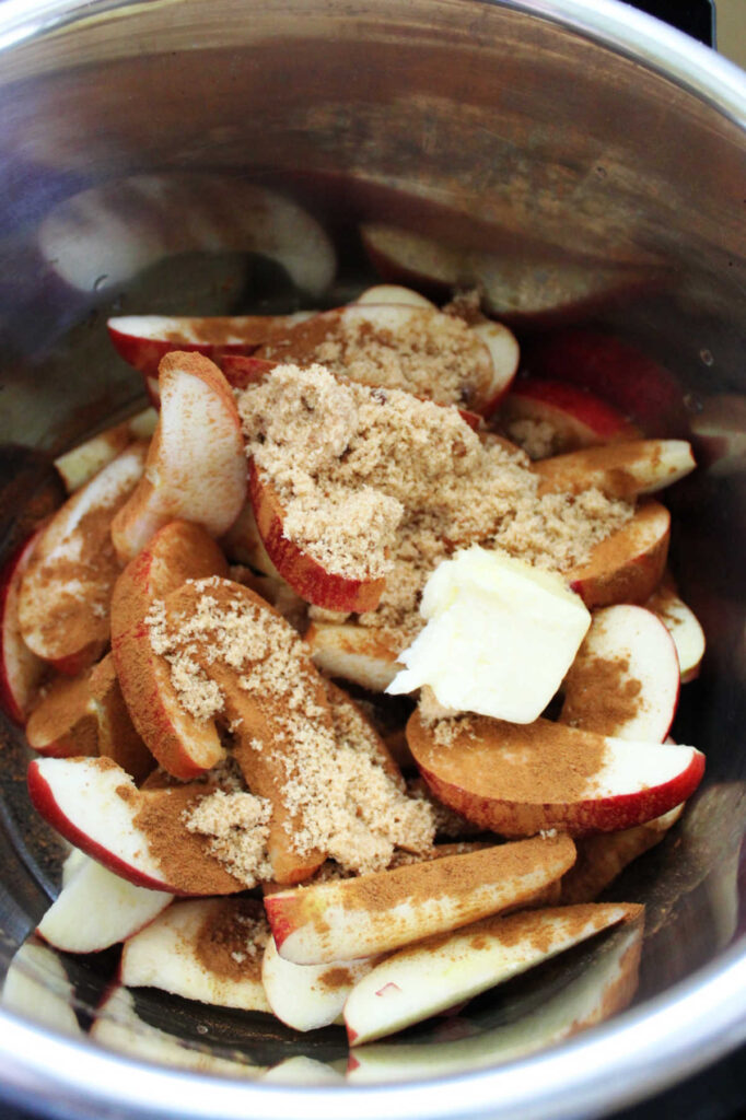 Slices of apples with brown sugar, cinnamon and butter in instant pot.