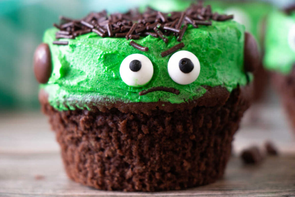 Frankenstein cupcake with green frosting, sprinkle hair and candy eyes.