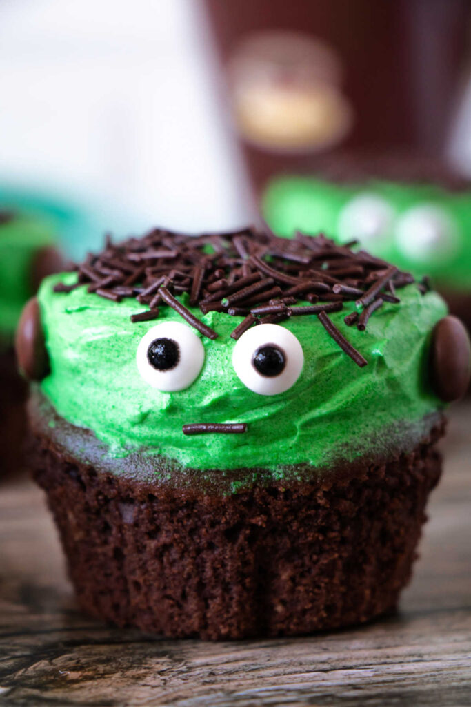 Cute Frankenstein cupcake with chocolate sprinkle hair and candy eyes.