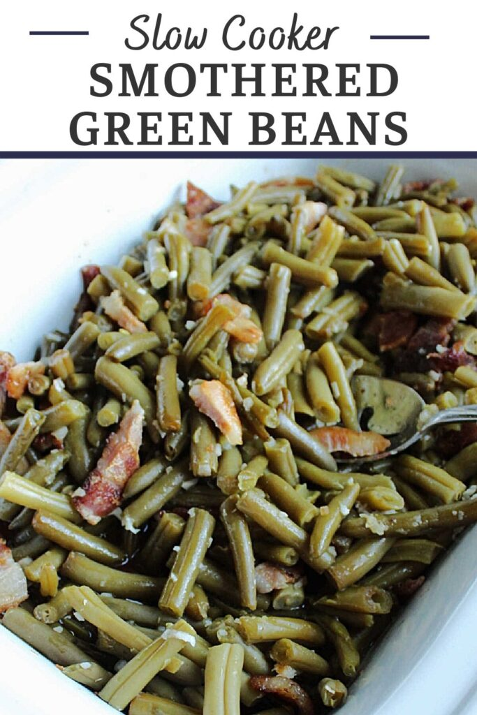 Slow cooker smothered green beans are the perfect side dish for almost any meal. They are easy to make, have a great sweet and sour sauce and plenty of bacon to make them extra tasty!