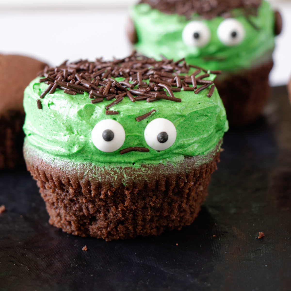 Chocolate cupcake decorated like Frankenstein for Halloween.