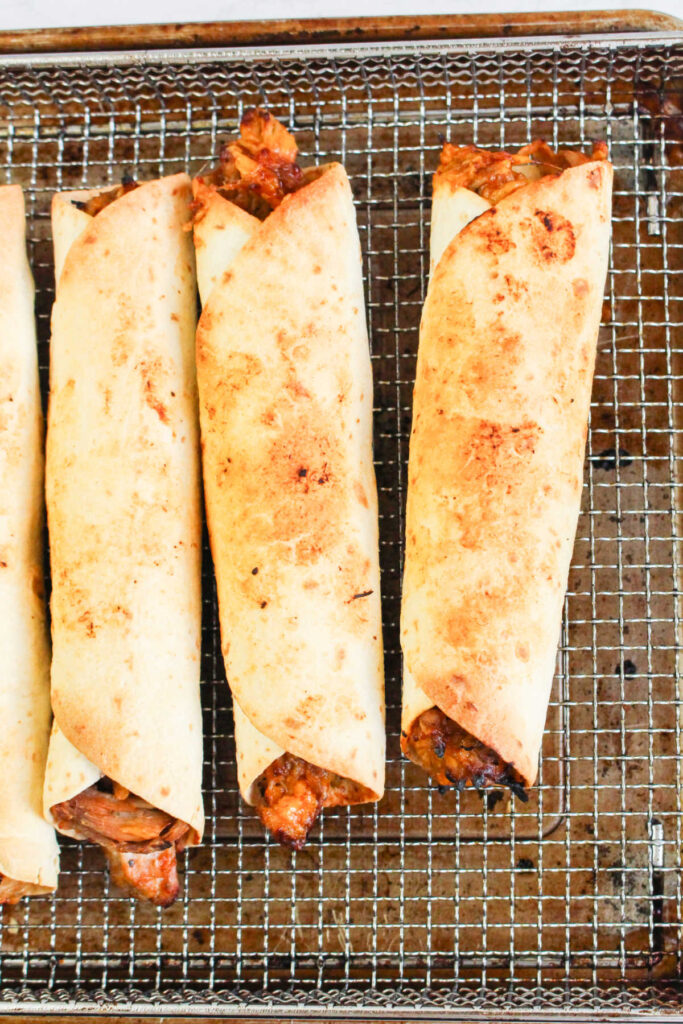 Golden pulled pork taquitos fresh from the air fryer.