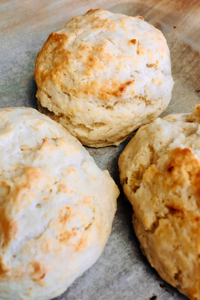 Close up of golden brown freshly baked biscuits.