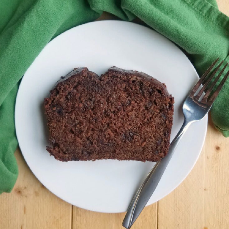 Slice of chocolate banana sourdough quick bread on plate with fork.