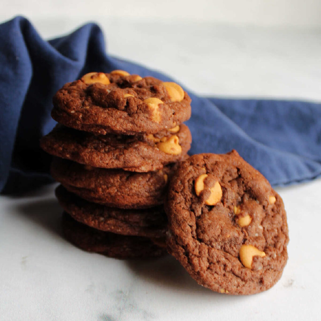Stack of chocolate cookies with peanut butter chips.