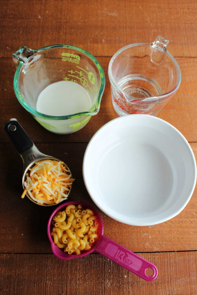 Milk, pasta and cheese ready to be made into easy mac, ingredient shot.
